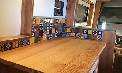Mexican tiles splash back to protect the van while cooking